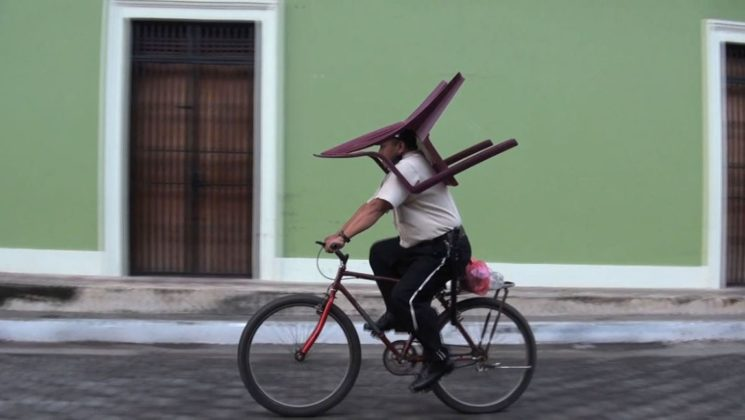 Chair man, a live video edit, approx 35 min, 2014 : Chair man is a live edit of video footage shot in Nicaragua. It shows her repeatedly following a man who carries a plastic chair on his head while riding a bicycle to and from work. Fascinated by this phenomenon – his balancing act – Oltheten continues to film him. Her presence begins to exert an influence on his daily routine, prompting slight changes in the pattern as the man becomes aware of the camera and the documentation of his actions. While searching and clicking through the rough video edits Oltheten shares anecdotes, at other times leaving the image alone to speak for itself. These manipulations create an associative narrative that allows Oltheten to emphasize particular scenes, events and qualities on the spot.